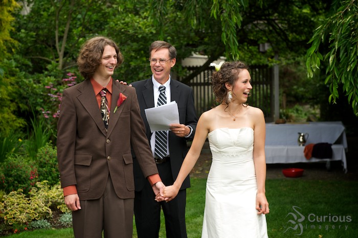 bride groom and minister laughing