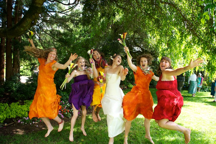 bridesmaids jumping in the air