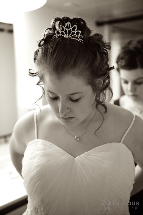 bride getting ready. sepia tone black and white