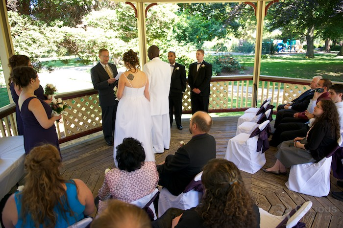 bride and groom getting married in gazebo
