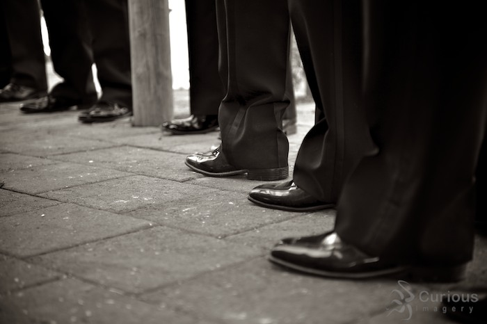 B&W of groom's shoes