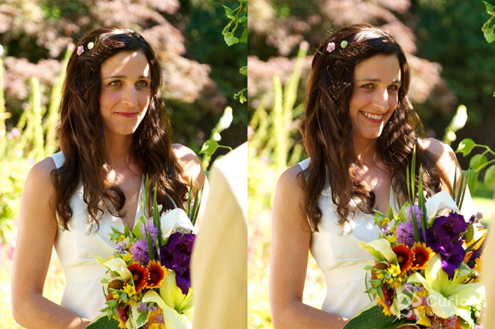 bride smiling at groom while he reads vows