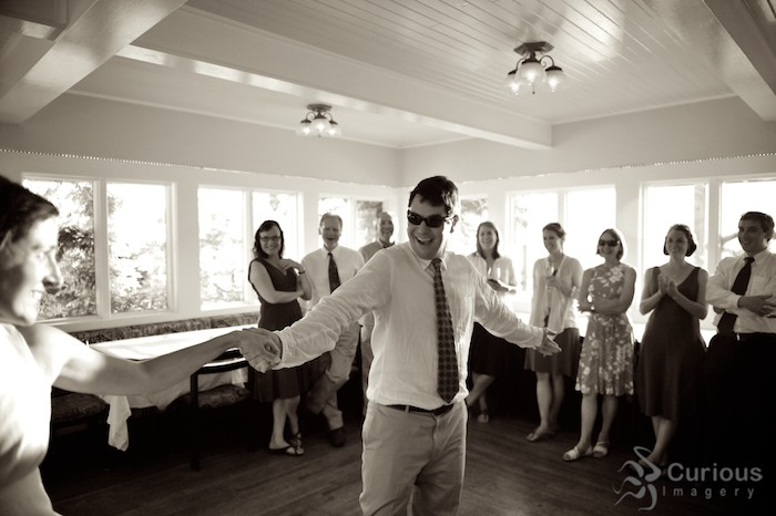 groom having fun dancing with bride at willows in, black and white