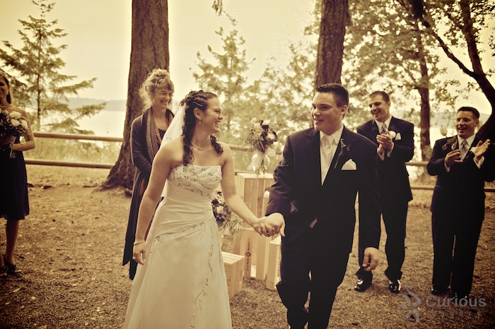 enthusiasitc bride and groom lead recessional. antique cross processed color.