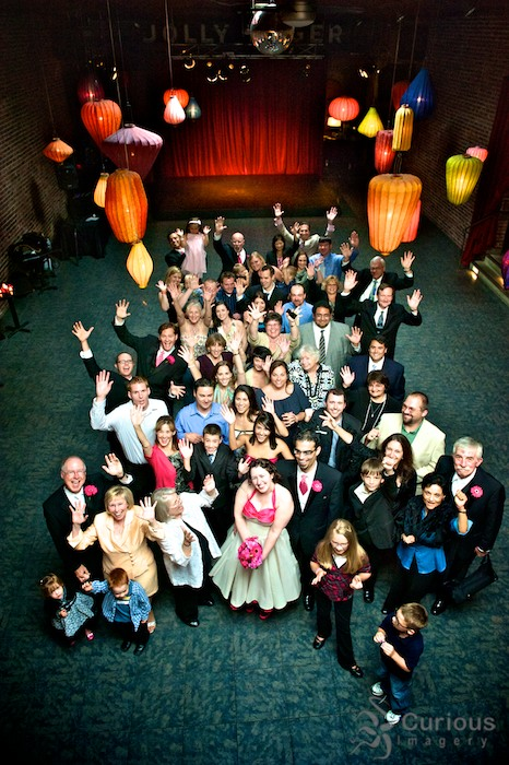 Giant group photo with entire wedding party and all the guests. Location, Georgetown Ballroom Seattle. Jazz Hands!