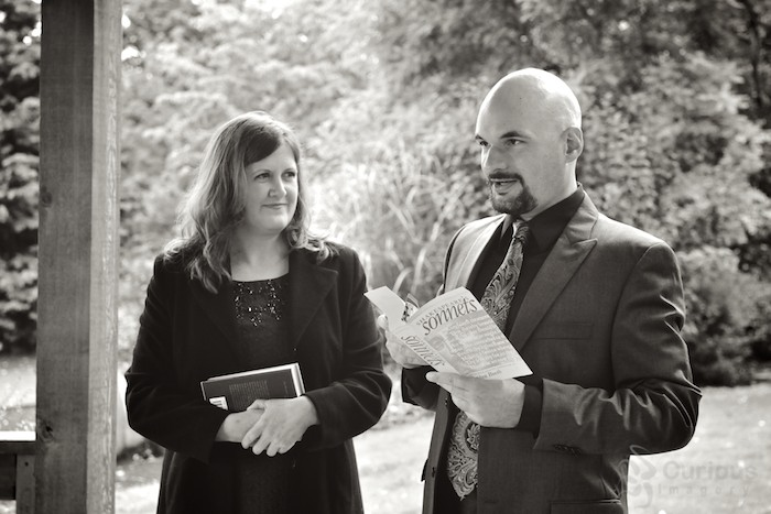bride and groom exchange vows at Evergreen Arboretum and Gardens in Everett. Groom reads Shakespeare sonnette