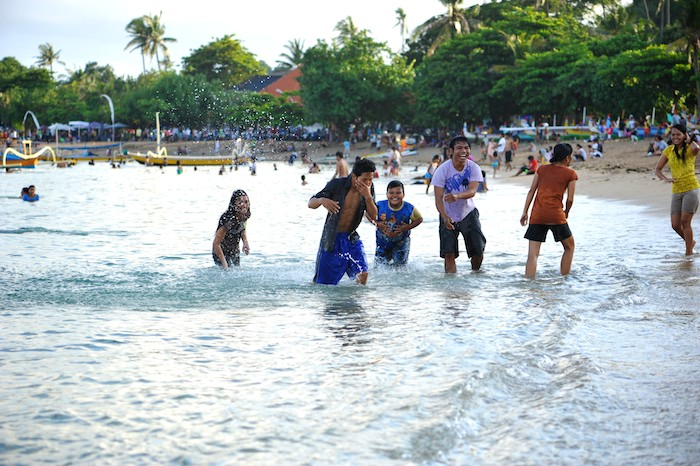 Vacationers from Jakarta enjoying Sanur Beach in Bali