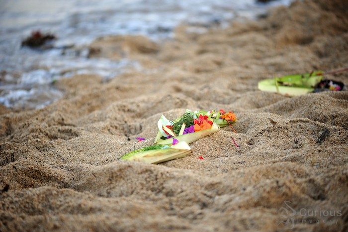 Hindu offering by the rising tide at Sanur Beach in Bali