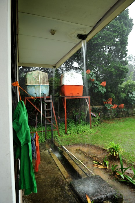 laundry and water tanks in rain at Puncak
