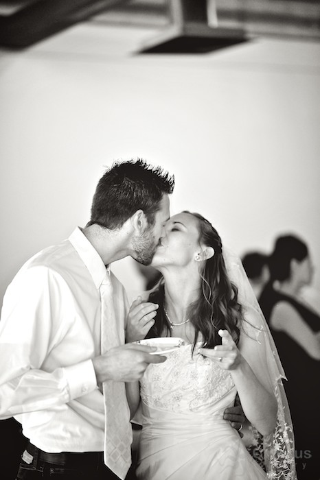 Bride and groom kiss! Black and White.